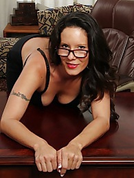 Busty older secretary Desire Delgoto strips naked pictures at freekilopics.com
