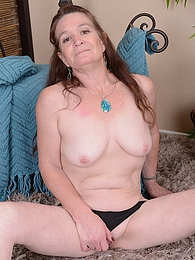 Horny grandma Anna spreads her older pussy pictures at freekiloporn.com