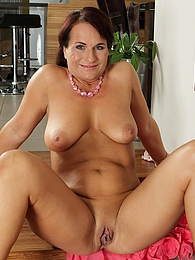 Big titted curvy mature babe Katherine Ross strips pictures at freekilosex.com