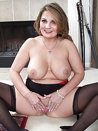Big breasted wife Cherrie Dixon spreads her pussy lips pictures at lingerie-mania.com