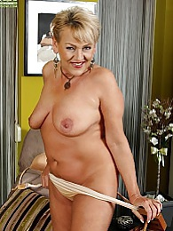 Curvy older wife Andrea strips butt ass naked pictures at lingerie-mania.com