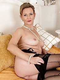 Older wife Huntingtdon Smyth naked in stockings pictures at kilosex.com