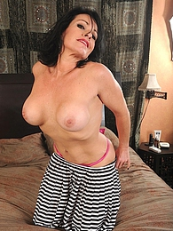 Busty cougar Braxton Kai toys her hungry pussy pictures at freekiloclips.com