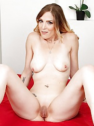 Mature babe Samantha Sheridan masturbating on bed pictures at kilosex.com