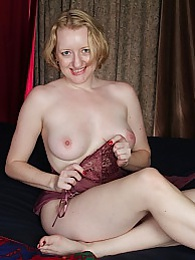 Anya Volcov stuffs her mature pussy with sex toy pictures at kilosex.com