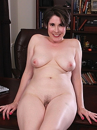 Busty mature babe Sadie Jones naked on her desk pictures at kilopics.com