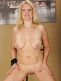 Busty mature babe Zoey Tyler licks her big natural tits pictures at freekilosex.com