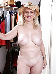 Busty older babe Judy Belkins spreads pussy in closet pictures