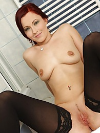Redhead Verona Vaughn wearing only her black stockings pictures at freekilomovies.com