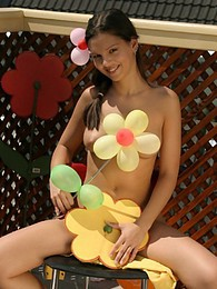 Eva plays with balloons pictures at adspics.com