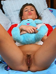 Sweet teen Natalya removes her panties to finger fuck her pussy pictures at freekilosex.com