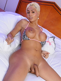 Irresistible tgirl Olivia Starr posing on the bed pictures at find-best-tits.com