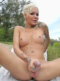 Horny tgirl posing her long hard cock outdoors pics