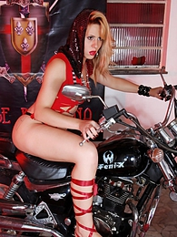 Hot tranny posing on a motorcycle pictures at lingerie-mania.com