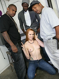 Black guys pull a train on a sexy redhead Scarlett Oreilly pictures at freekilomovies.com