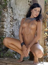 Stunning young brunette exposes her tits and pussy outdoors pictures at kilopics.com