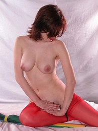 Cute redhead posing naked in the studio pictures at kilosex.com