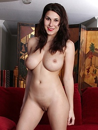 Busty brunette babe Ella Jones exposes her shaved pussy on the sofa pictures