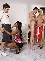 Ebony beauty and her blonde pal get a pair of cocks to share pictures