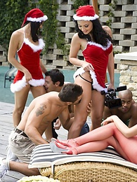 Santa's sexy helpers hold a pool side naughty gang bang pictures at lingerie-mania.com