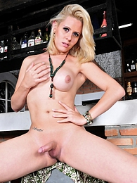 Hot shemale blondie Mel Voquel posing pictures at relaxxx.net