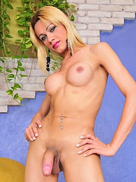 Sweet tranny Agatha exposing her sweet ass and cock pictures at freekiloclips.com