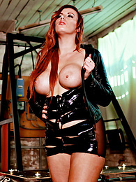 Busty Redhead in Latex Yuffie Yulan Gets a Good Dogging pictures at lingerie-mania.com