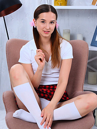 Stunning slim teen angel pulls off her skirt and cute underwear showing her beautiful naked body pictures at kilopics.net