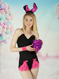 This tight blonde bunny has some smoking hot fun with stripping her clothes and playing with her flower pictures at freelingerie.us