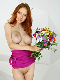 Irresistible doll with exceptional features and a beautiful face in high heels spreading her thin legs in a white seat with flowers pictures at find-best-mature.com