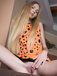 A wonderful teen doll like her just knows how to tease all her boys to the max and does so as she takes all her clothes off pictures at kilotop.com