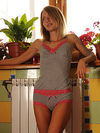 Stripping her top to show those nice tiny tits is all in the routine for this wonderful blonde teen pictures at kilopics.net