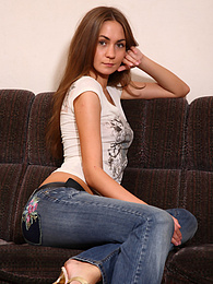 Cute teen spreads her pussy on the couch pics