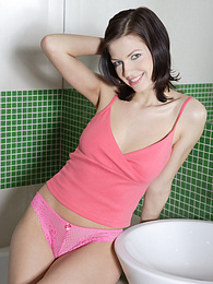 Sexy brunette fucks her tasty trimmed pussy with a big dildo in the bathroom pictures at find-best-mature.com