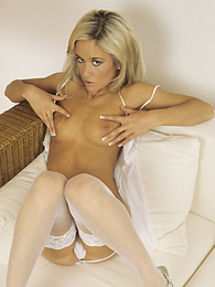 Pretty young blonde spreads her wet pussy wide open pictures