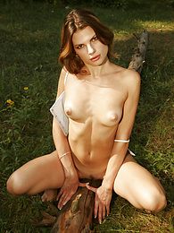 Sexy brunette flashing pussy in the woods pictures at adipics.com