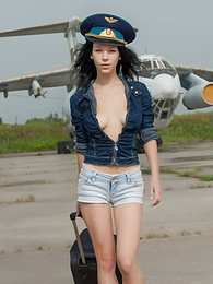 Hot teen pilot strips on the airstrip before she strips off all of her clothes and shows pussy instead of her duty. pictures at adipics.com