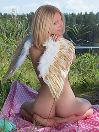 Amazing blonde teen babe gets naked on the lap of nature and tries to mimic some angelic beauty with her poses. pictures at freekilopics.com