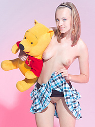 Admirable teen beauty in striped gaiters with a teddy bear undressing and spreading legs. pictures at freekilosex.com