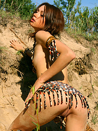 Gorgeous teen girl dressed up in exotic outfit shows off her sweet naked body outdoors. pics