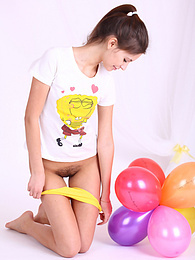 Lovely teenage cutie plays with balloons and gets nude revealing her totally unshaven twat. pictures