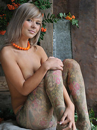 Smiling babe with big all natural tits poses in fancy pantyhose then strips them off. pictures at find-best-babes.com