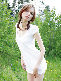 Timid teen girl comes to the nature and poses her beautiful body in front of the camera. pictures