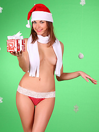 Perfect brunette teen in Santas Hat and dotted red pants strips and seduces us with her fantastic forms. pictures at kilogirls.com