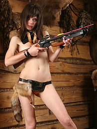 Naughty teen girl with delicious parts dreams of becoming a good hunter in the future and shows her skills. pictures
