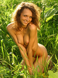 Playful chick with irresistible smile and sexiest body enjoys walking nude in the daisy field. pictures at kilogirls.com