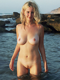 Warm water of the sea and beautiful view of sunset make sweet mermaid expose her irresistible body for you. pics