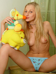This Blonde beauty teen enjoys posing her most intimate parts on camera with her favorite toy. pictures