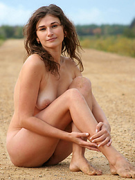 Lovely brunette comes to the nature and having lost her clothes, demonstrates her sensitive body. pics