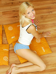 Amazing blonde nude teen decided to place herself at the attic of her wooden house on four orange pillows for her dirty intention. pictures at reflexxx.net